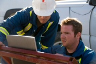 Picture of 2 workers completing online training at site